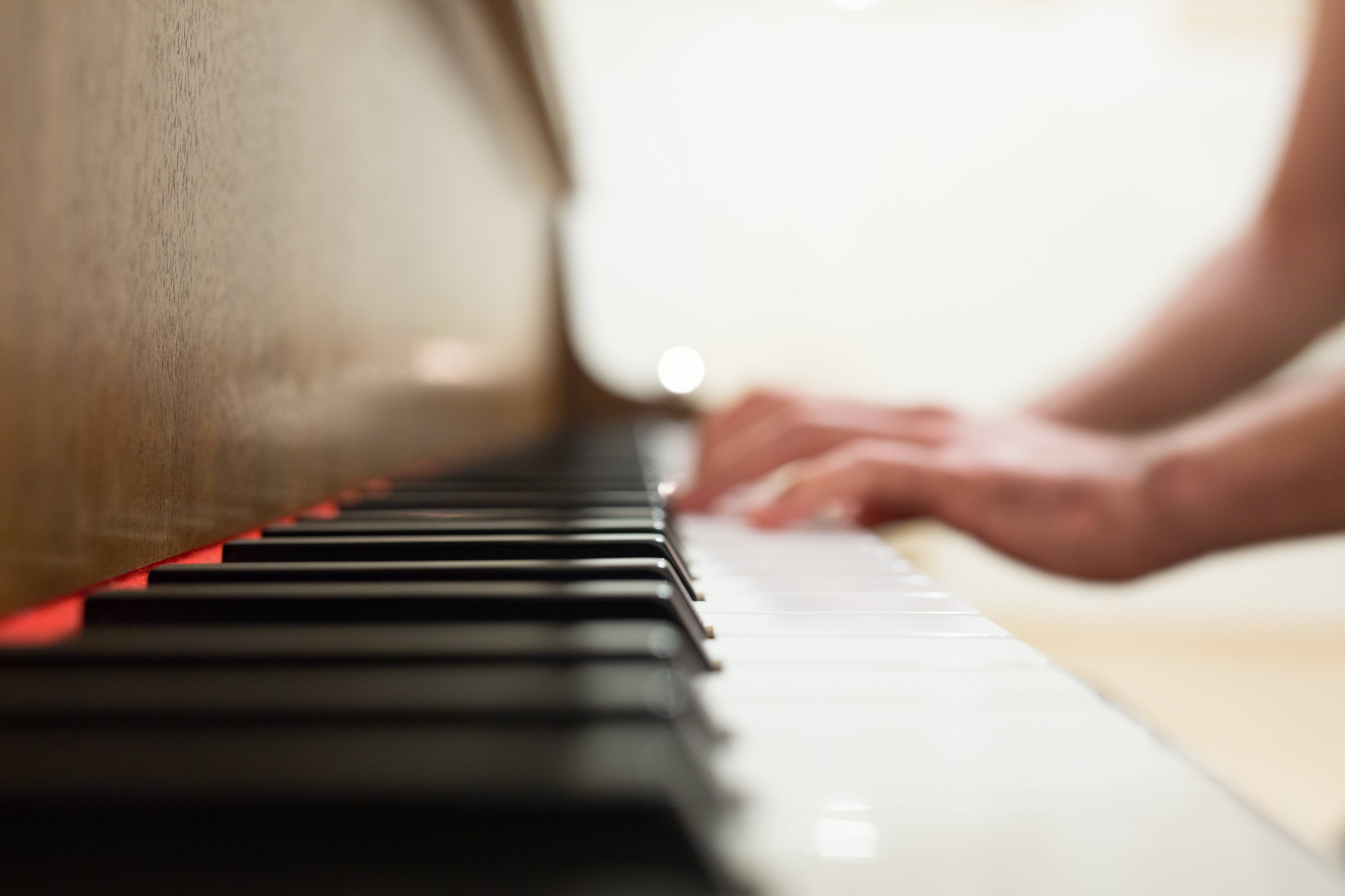 Person Playing Piano by Negative Space